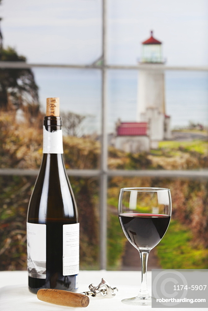 Close up of bottle of wine and glass on table, Long Beach, Washington, USA