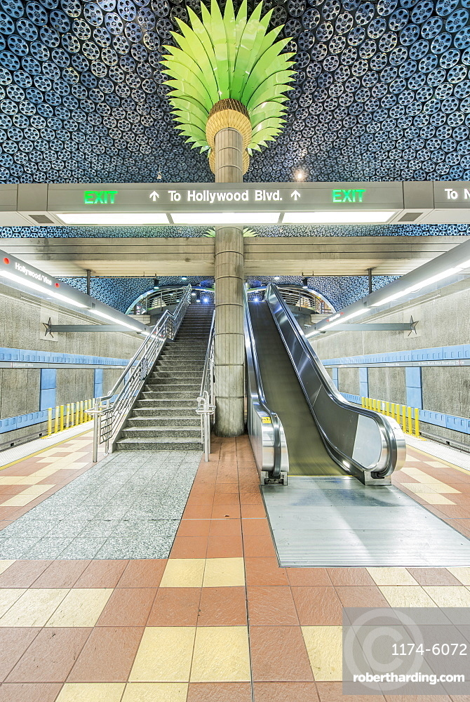 Ornate pillars, escalator and movie reels on ceiling in subway station, Los Angeles, California, United States