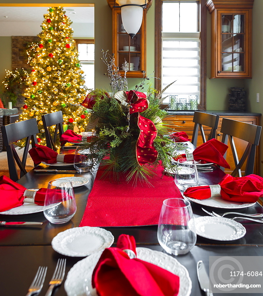Christmas table and tree in dining room