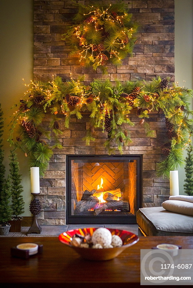 Christmas wreaths over fireplace in living room