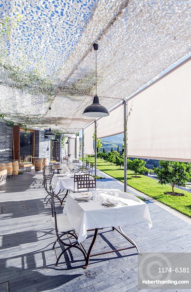 Tables at open-air cafe, Peso da Regua, Vila Real, Portugal