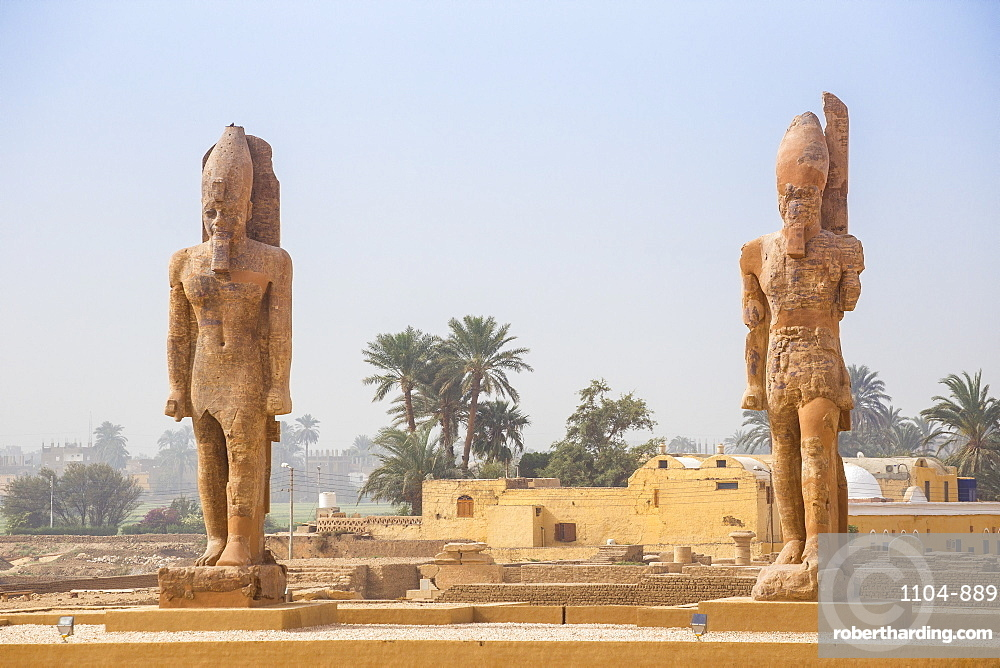 The Colossi of Amenhotep III at the Northern Gate of the Temple of Amenhotep III, UNESCO World Heritage Site, West Bank, Luxor, Egypt, North Africa, Africa