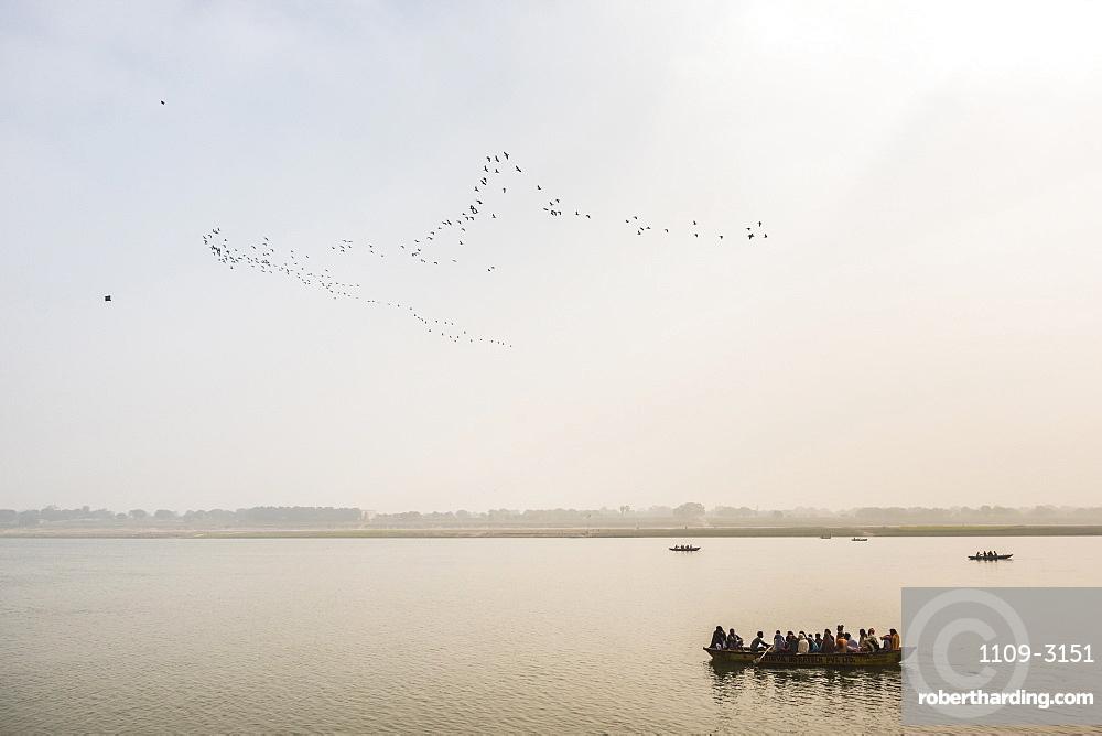 Pilgrims on a boat on the River Ganges, Varanasi, Uttar Pradesh, India, Asia