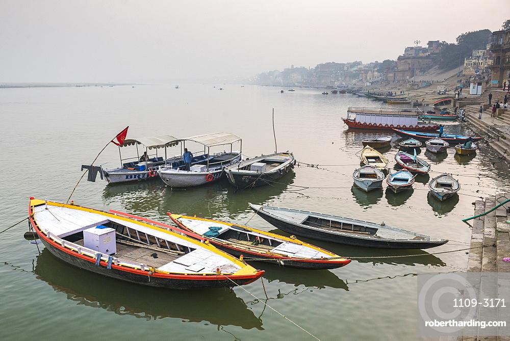 Boats in the mist at dawn on the River Ganges, Varanasi, Uttar Pradesh, India, Asia
