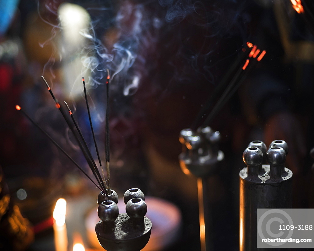 Incense burning at a Hindu temple in New Delhi, India