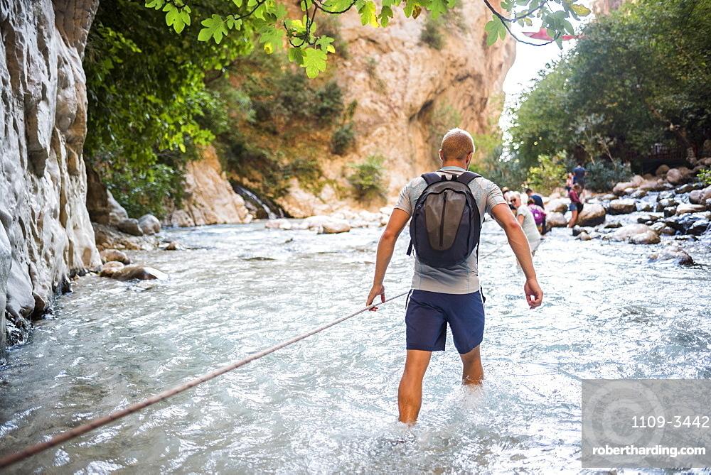 Tourist hiking in Saklikent Gorge, Saklikent National Park, Fethiye Province, Lycia, Anatolia, Turkey, Asia Minor, Eurasia