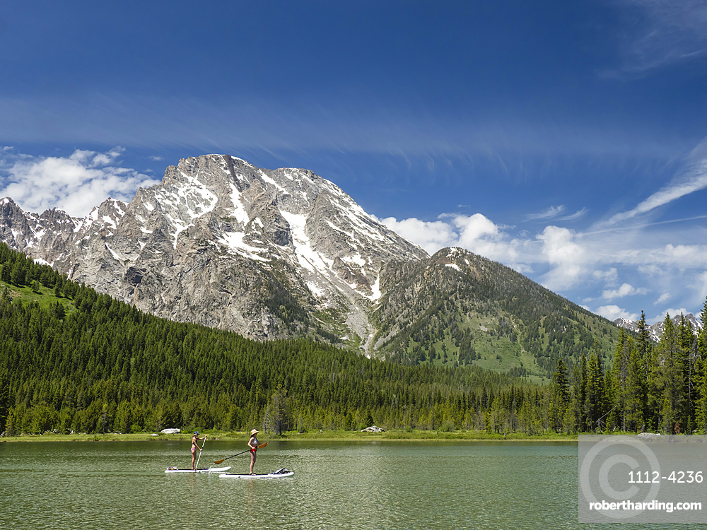 Stand up paddle boarders on String Lake, Grand Teton National Park, Wyoming, United States of America, North America