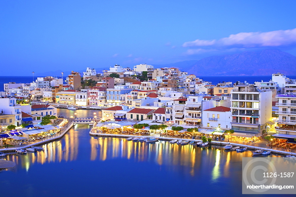 Agios Nikolaos Harbour from an elevated angle at dusk, Agios Nikolaos, Crete, Greek Islands, Greece, Europe