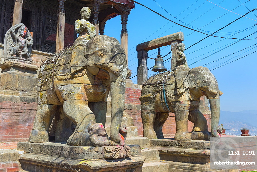 Ganesh Shrine, Uma Maheshwar Temple guarded by two stone elephants, Kirtipur, Nepal, Asia