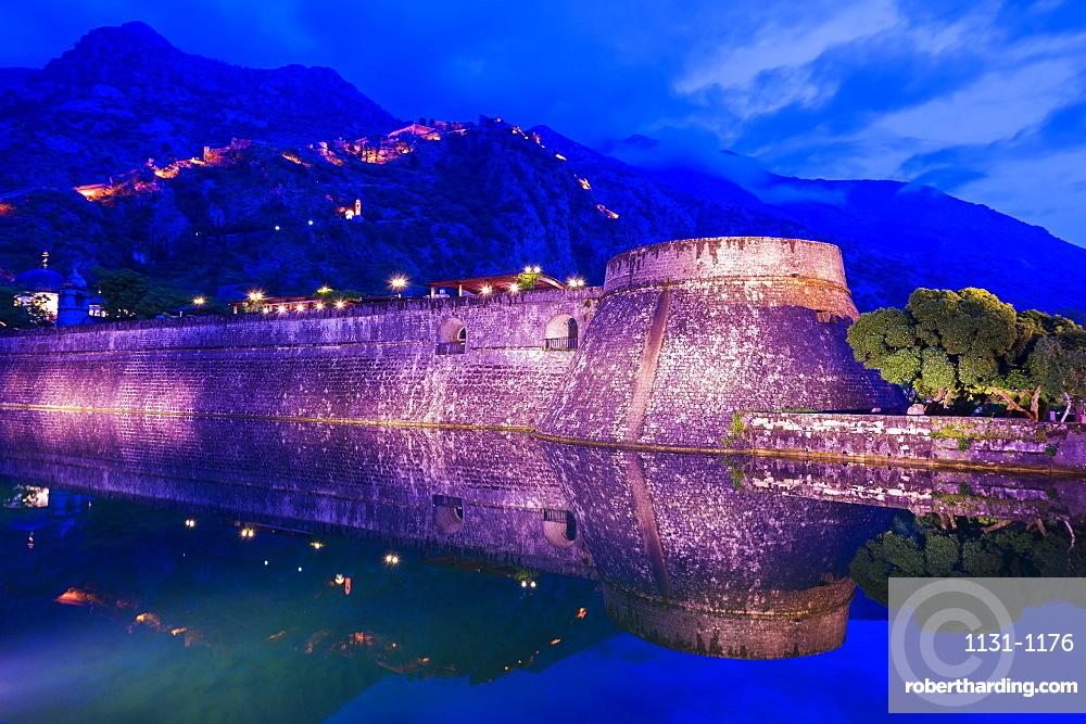 City ramparts at night in Kotor, Montenegro, Europe