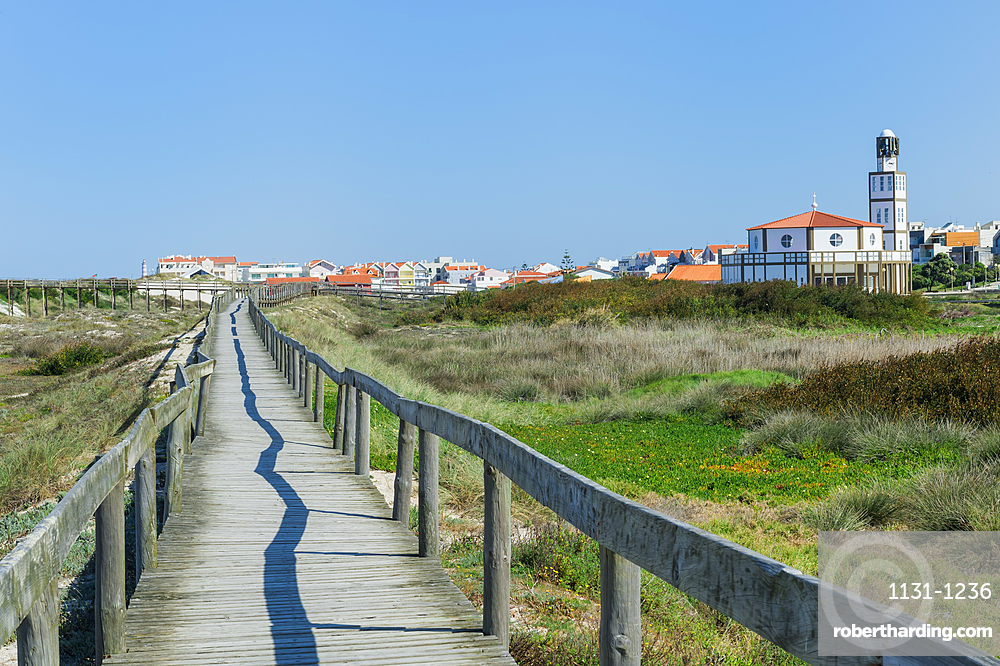 Wooden footpath at Costa Nova Beach, Costa Nova Church behind, Aveiro, Venice of Portugal, Beira Littoral, Portugal
