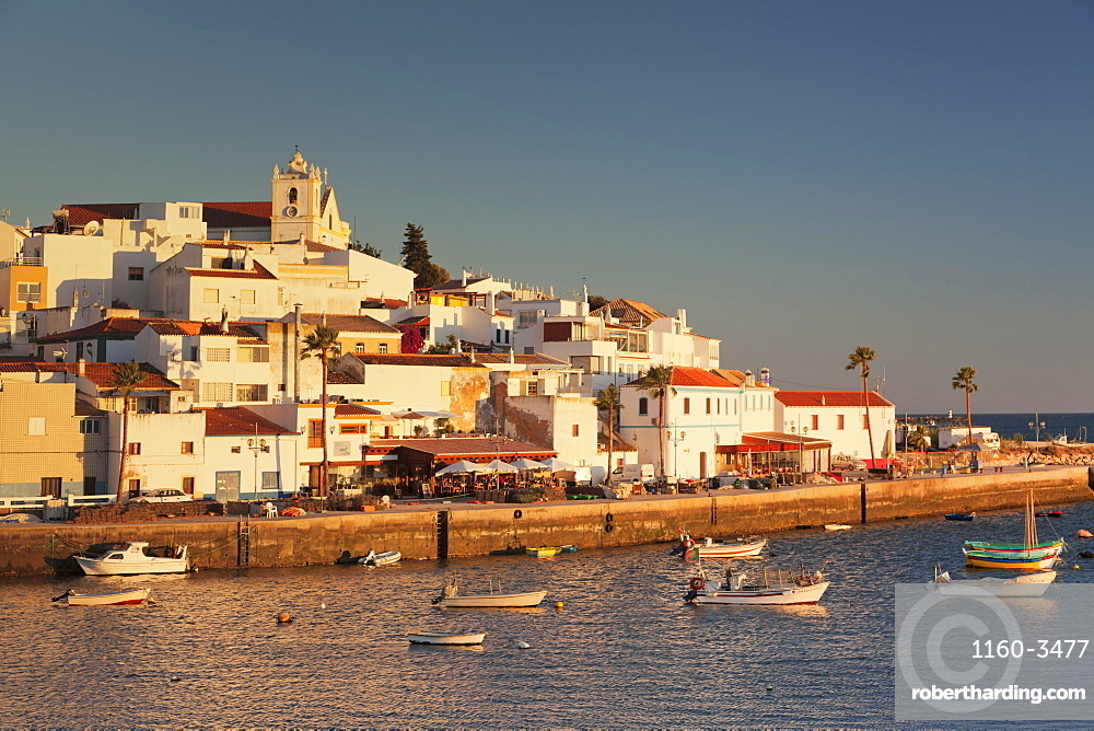 Ferragudo fishing village at sunset, near Portimao, Algarve, Portugal