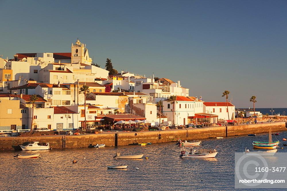 Ferragudo fishing village at sunset, near Portimao, Algarve, Portugal, Europe
