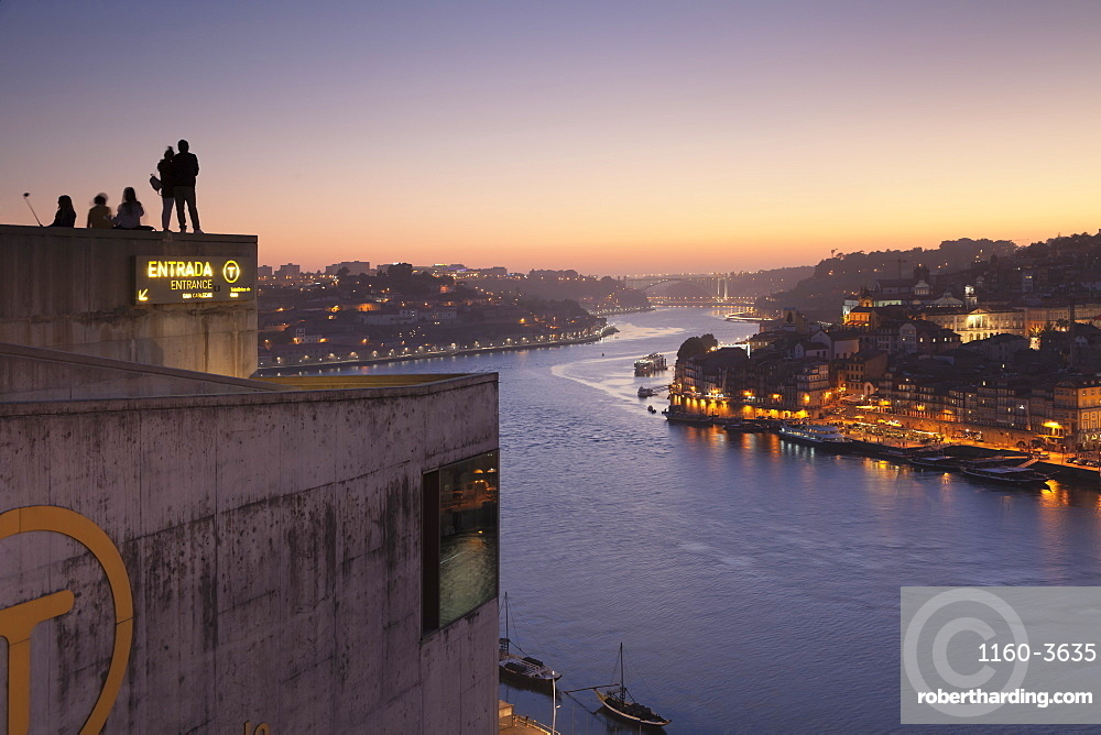 View from Vila Nova de Gaia View over Douro River at sunset to Ribeira District, UNESCO World Heritage Site, Porto (Oporto), Portugal, Europe