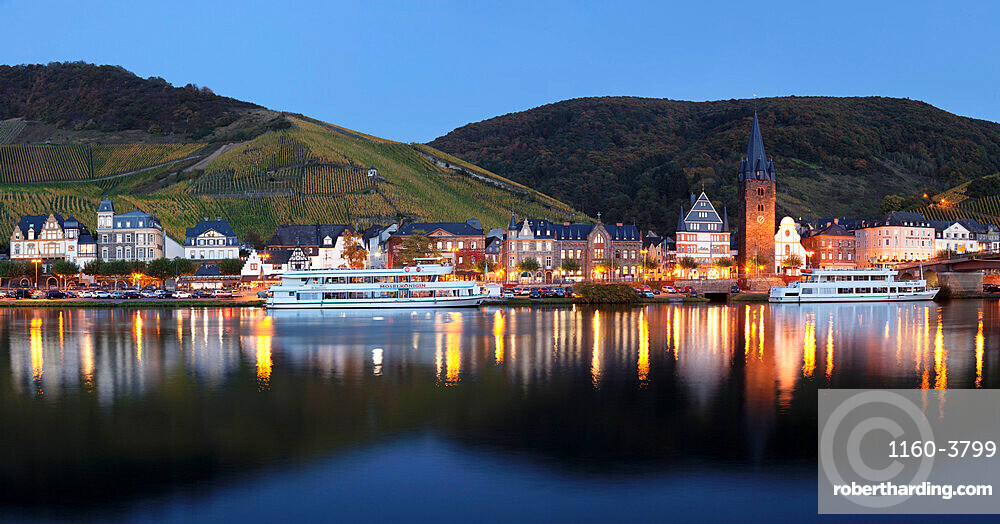 Bernkastel-Kues reflected in Moselle River, Rhineland-Palatinate, Germany, Europe