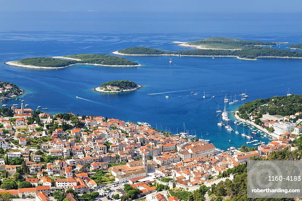 Elevated view of the old town and Pakleni Islands, Hvar Island, Dalmatia, Croatia, Europe