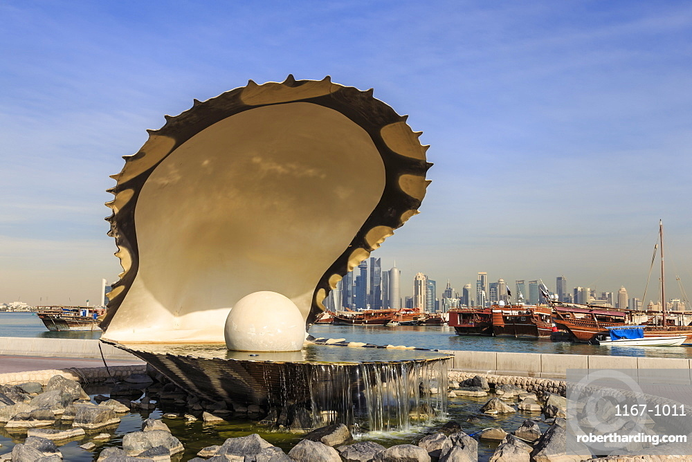 Pearl Monument with moored dhows and modern city skyline of West Bay, from Al-Corniche, Doha, Qatar, Middle East