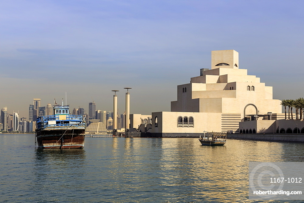 Museum of Islamic Art, dhow and modern city skyline of West Bay, from Al-Corniche, early morning, Doha, Qatar, Middle East