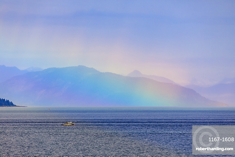 Boat, huge rainbow colours light up mist over the Fairweather Range, Icy Strait, near Glacier Bay, Inside Passage, Alaska, USA