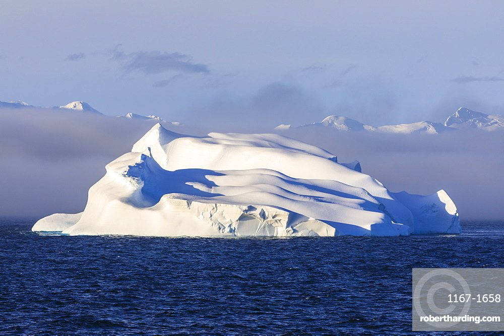 Huge iceberg, evening light, clearing mist, Bransfield Strait, near South Shetland Islands and Antarctic Peninsula, Antarctica, Polar Regions