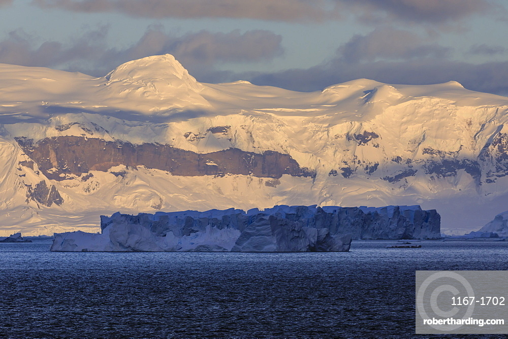 Sunrise, with atmospheric cloud and mist, mountains, glaciers and icebergs, Andvord Bay, Graham Land, Antarctica