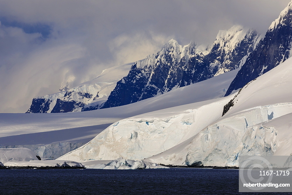 Glaciers, mountain peaks and dramatic clouds and sky, Cape Errera, Wiencke Island, Antarctic Peninsula, Antarctica, Polar Regions