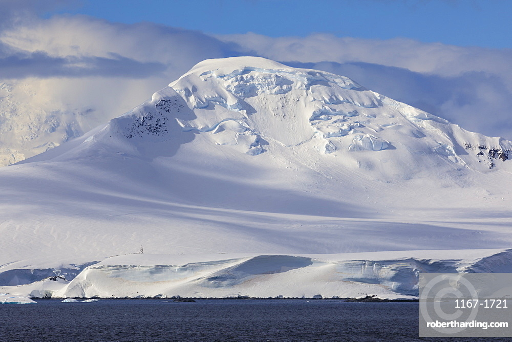 Glaciers, iceberg and misty mountains, off Cape Errera, Wiencke Island, Antarctic Peninsula, Antarctica