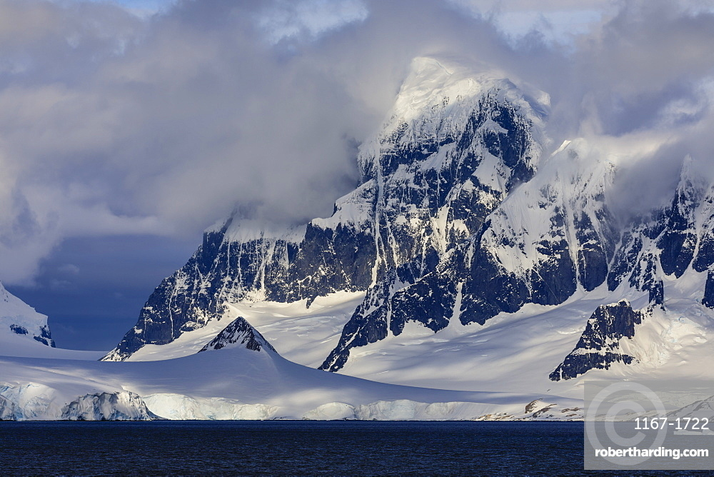 Glaciers and mountains of Cape Errera with dramatic sky, Wiencke Island, from Bismarck Strait, Antarctic Peninsula, Antarctica