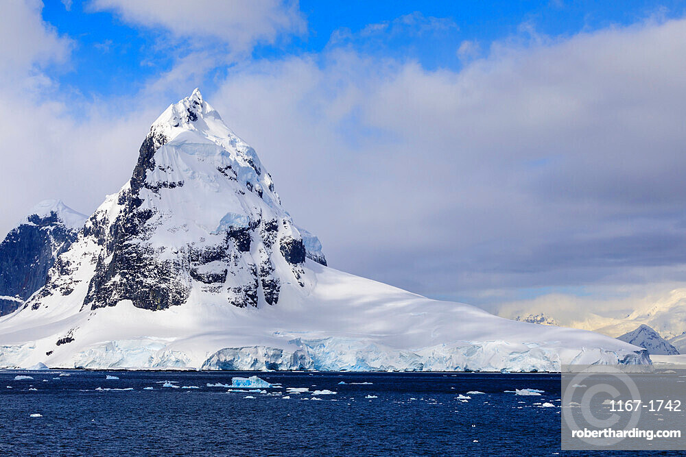 Mountains and glaciers of Cape Errera with blue sky, Wiencke Island, from Bismarck Strait, Antarctic Peninsula, Antarctica