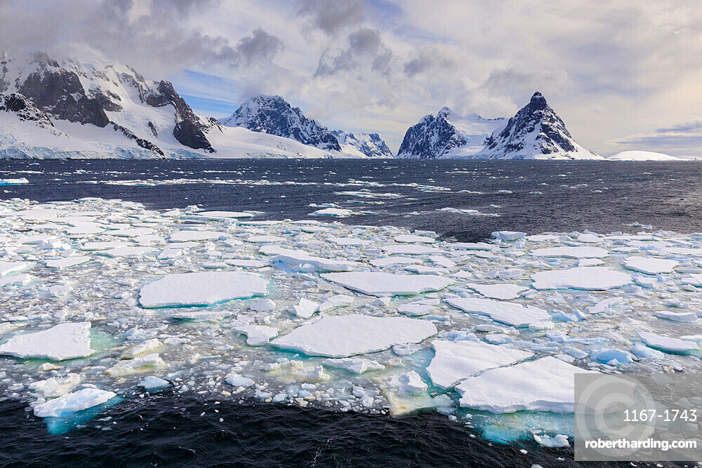 Sea ice and Lemaire Channel entrance, between Kiev Peninsula and Booth Island, evening light, Antarctic Peninsula, Antarctica