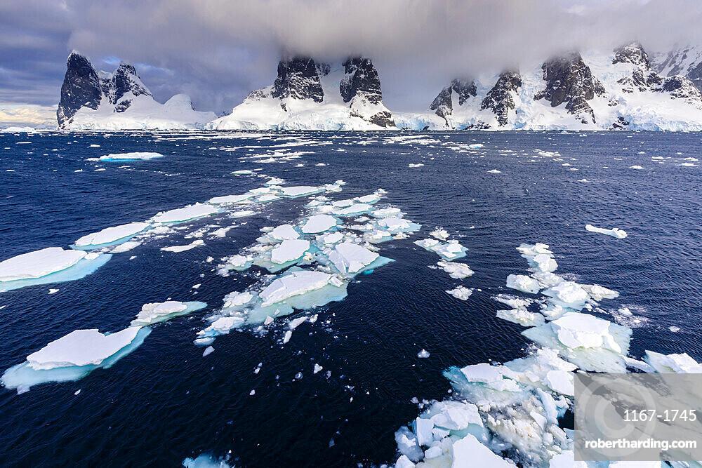 Sea ice off Una Peaks and False Cape Renard, Lemaire Channel entrance, Antarctic Peninsula, Antarctica