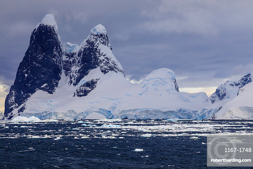 Una Peaks (Una's Tits), basalt ice-capped towers, False Cape Renard, Lemaire Channel entrance, Antarctic Peninsula, Antarctica