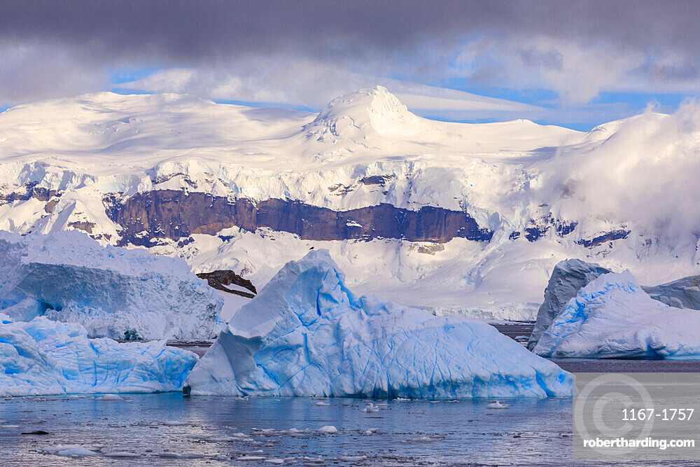 Blue icebergs and mountains, off Cuverville Island, Errera Channel, Danco Coast, Antarctic Peninsula, Antarctica