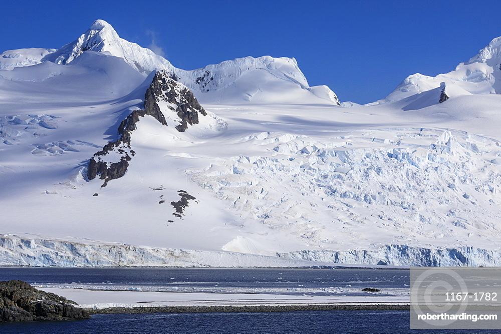 Low lying Half Moon Island, Livingston Island mountains and glaciers, evening sun, South Shetland Islands, Antarctica, Polar Regions