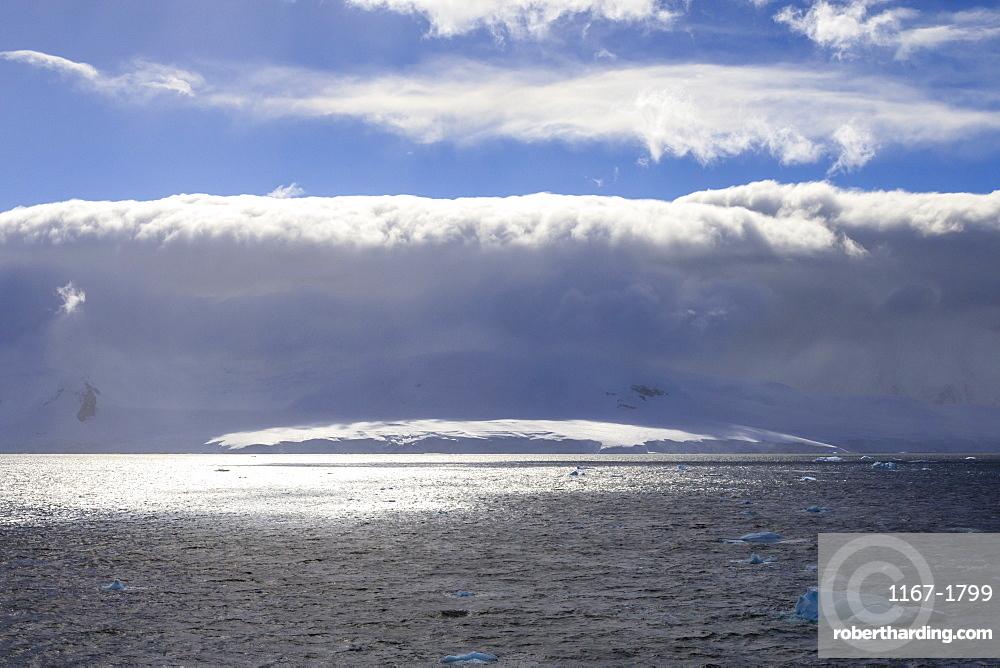 Arcus cloud over the mountains of the Gerlache Strait, blue sky, Antarctic Peninsula, Antarctica, Polar Regions