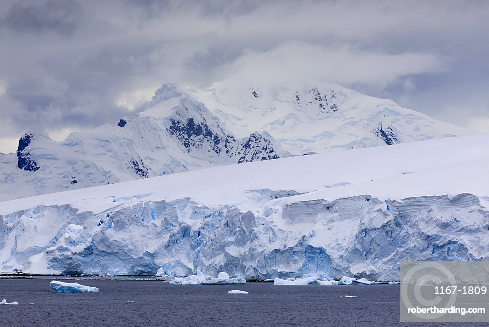 Low lying clouds over the mountains and blue glaciers of Paradise Bay, Antarctic Peninsula, Antarctica