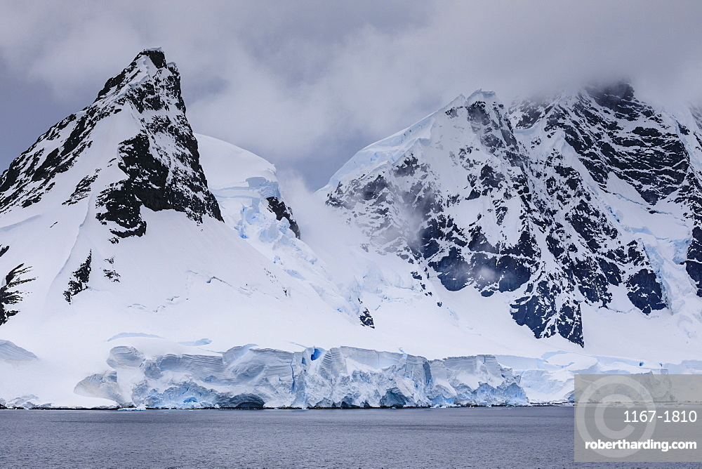 Low lying clouds over the cathedral mountains and glaciers of Paradise Bay, Antarctic Peninsula, Antarctica, Polar Regions