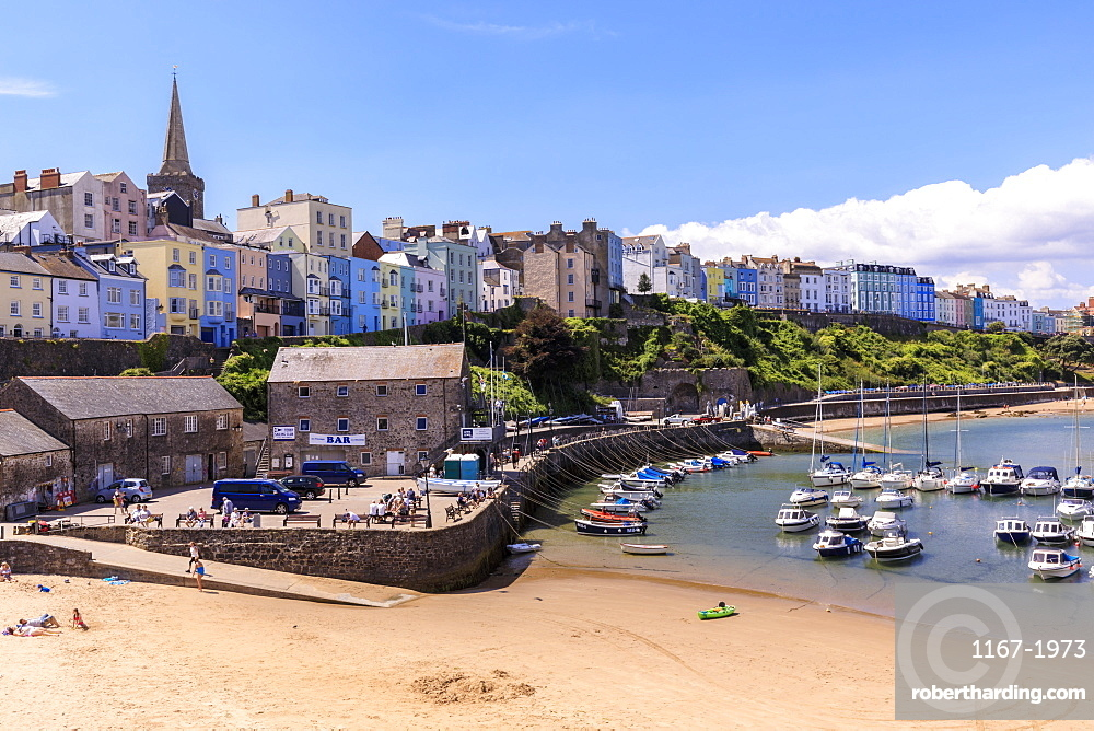Colourful historic town and St. Mary's church, from Harbour Beach, boats on a sunny day, Tenby, Pembrokeshire, Wales, United Kingdom, Europe