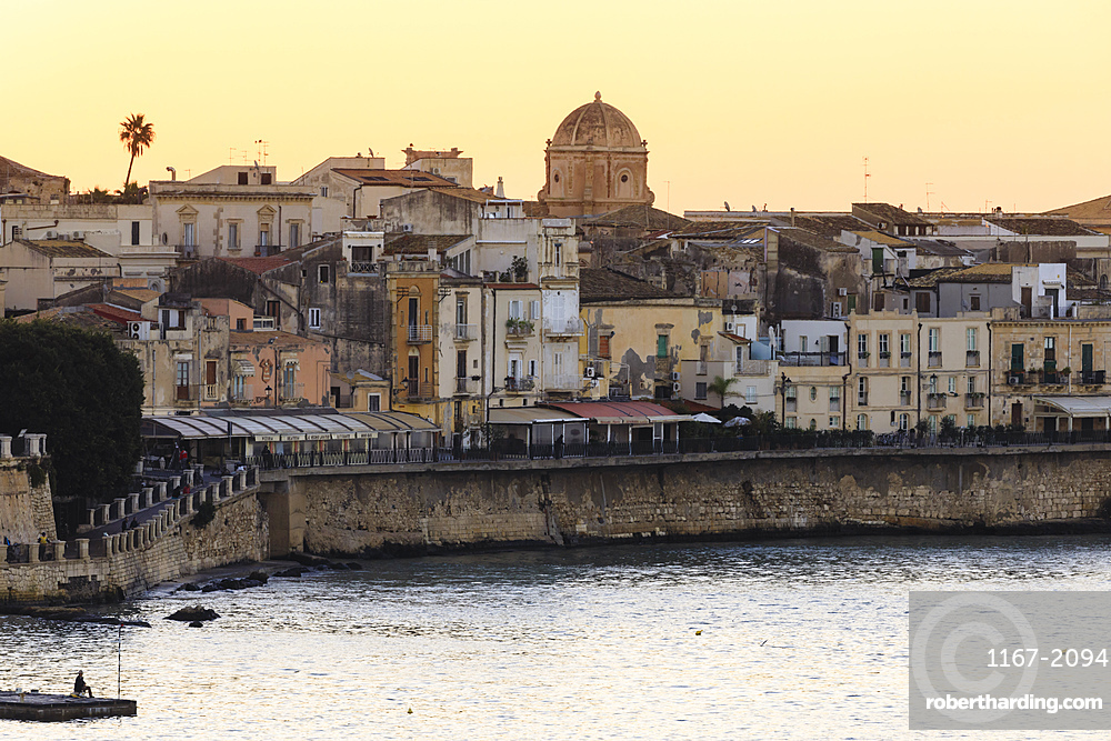 Sunrise over Ortigia (Ortygia), from the sea, fisherman on pier, Syracuse (Siracusa), UNESCO World Heritage Site, Sicily, Italy, Mediterranean, Europe