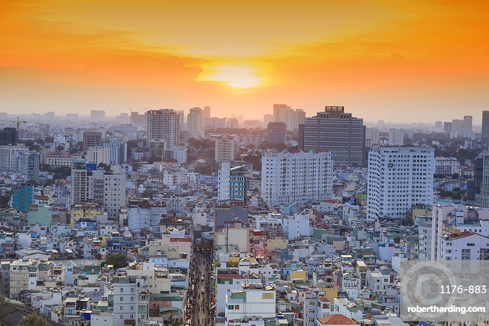 View of Bui Vien street and the skyline of downtown Ho Chi Minh City (Saigon)