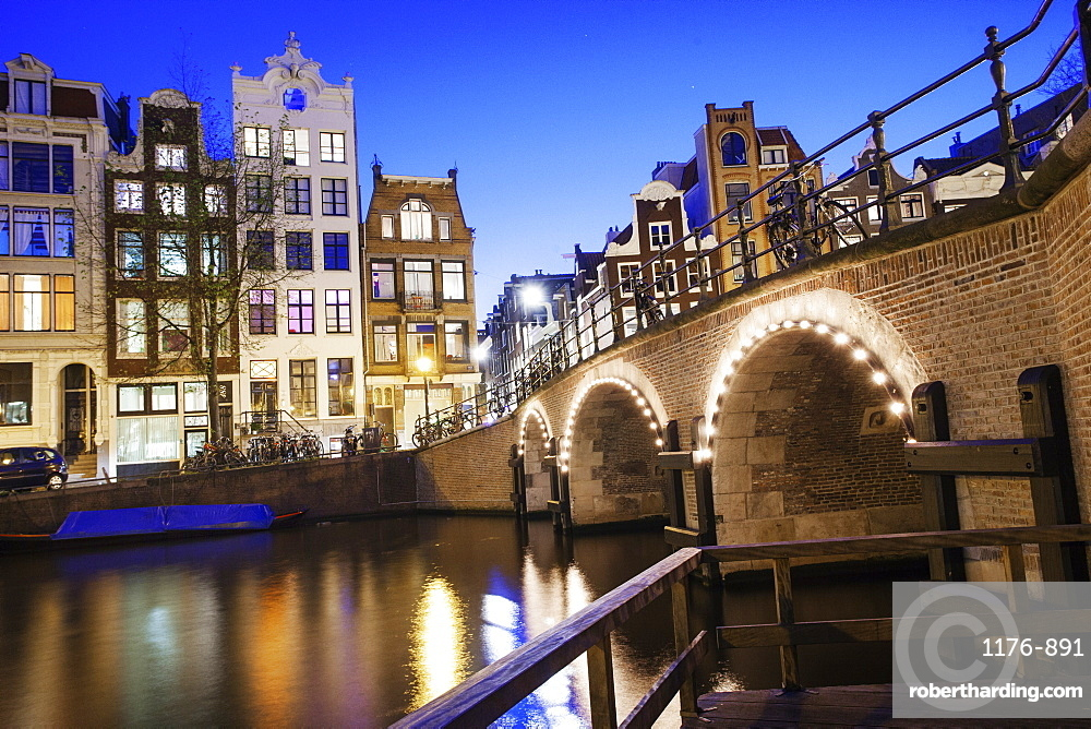 View of tall 18th century buildings on a canal in Amsterdam, Holland, Netherlands, Europe