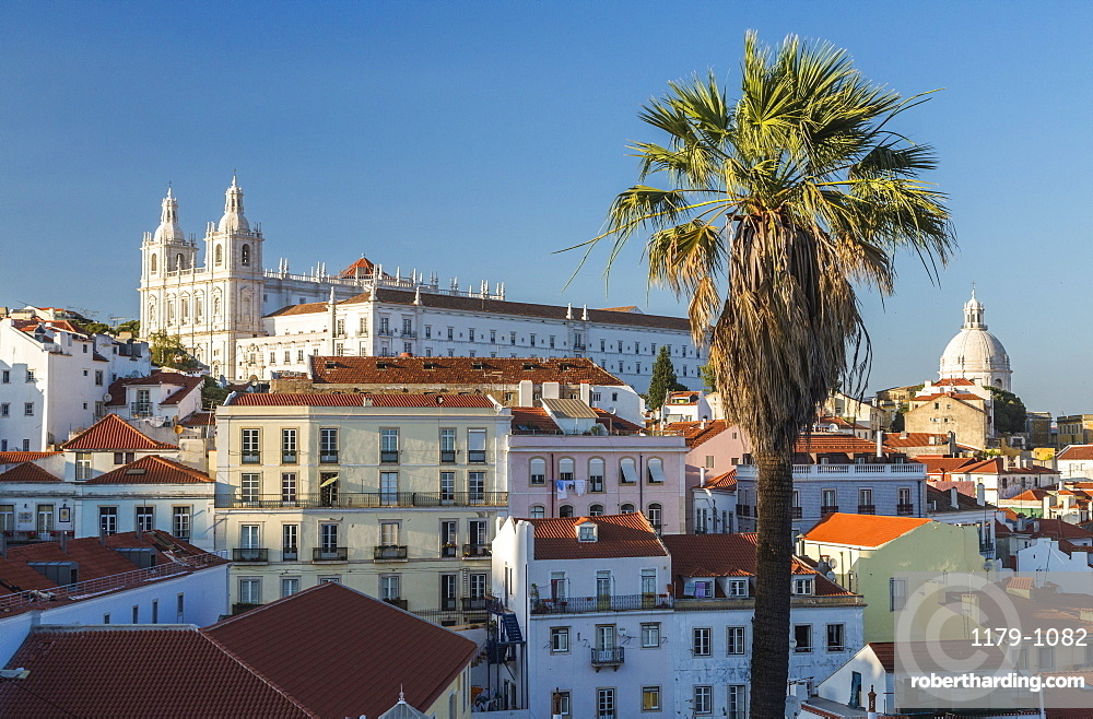 View of terracotta roofs and the ancient castle and dome from Miradouro Alfama viewpoint, Lisbon, Portugal, Europe