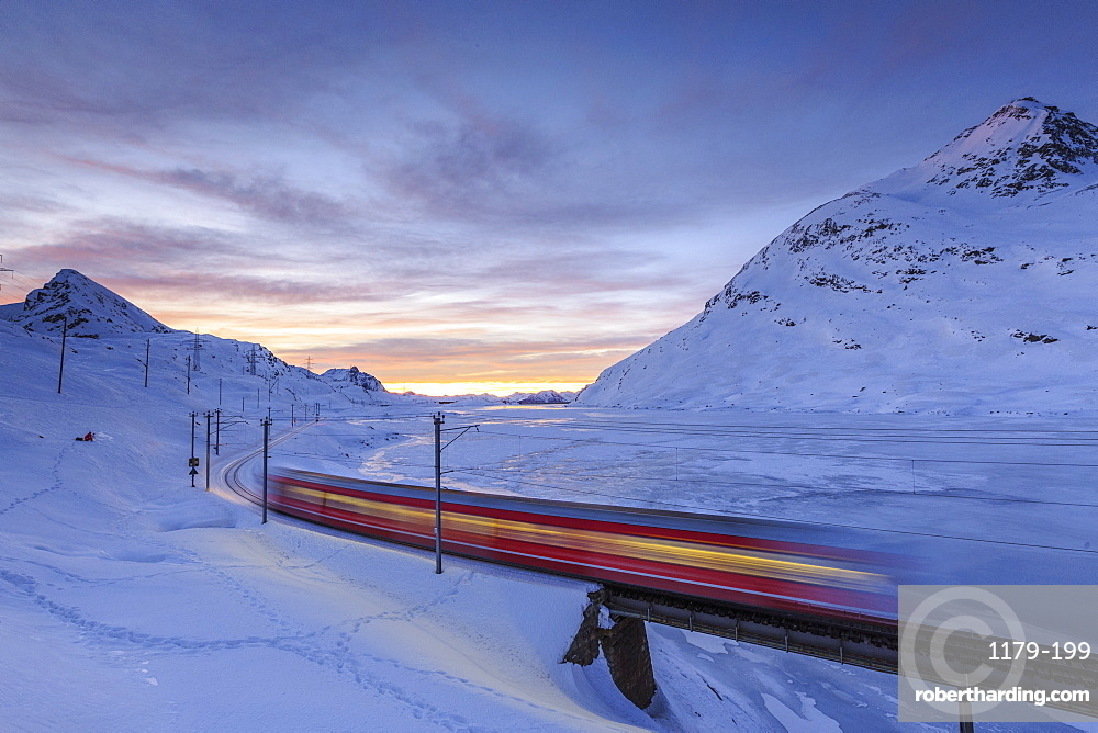 The Bernina Express red train, UNESCO World Heritage Site, Graubunden, Swiss Alps, Switzerland, Europe