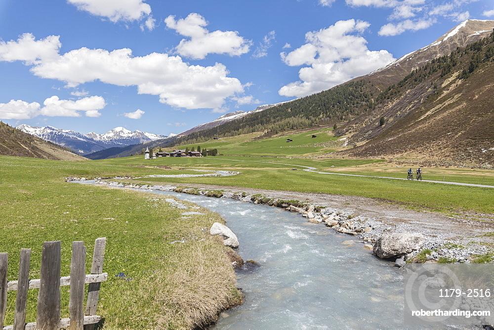 Transparent water of river around the alpine village of Davos, Sertig Valley, canton of Graubunden, Switzerland, Europe