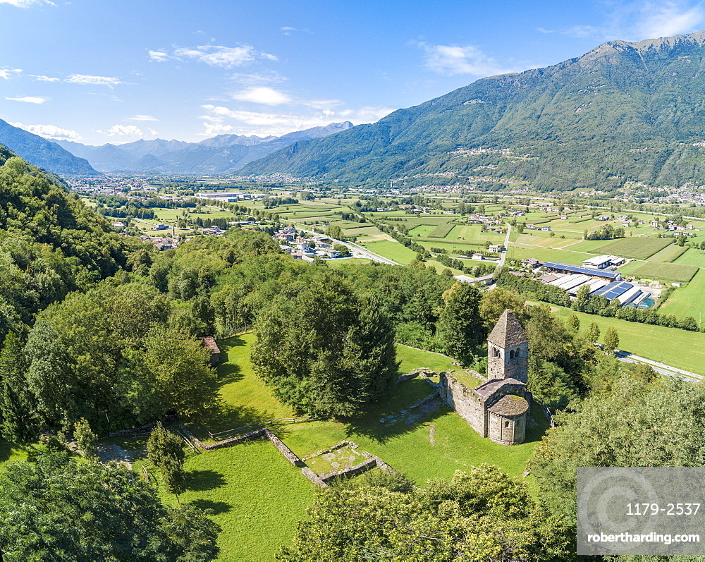 Panoramic of medieval Abbey of San Pietro in Vallate from drone, Piagno, Sondrio province, Lower Valtellina, Lombardy, Italy