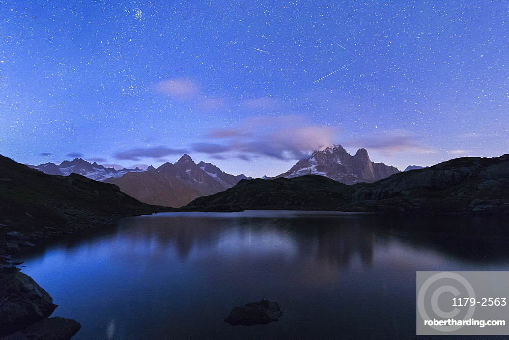 Shooting stars on the rocky peaks of Les drus and Aiguille Verte, Lacs De Cheserys, Chamonix, Haute Savoie, France