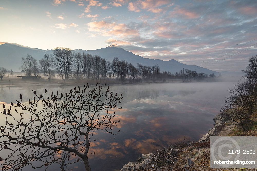 Clouds reflected in River Mera at dawn, Sorico, Como province, Lower Valtellina, Lombardy, Italy, Europe