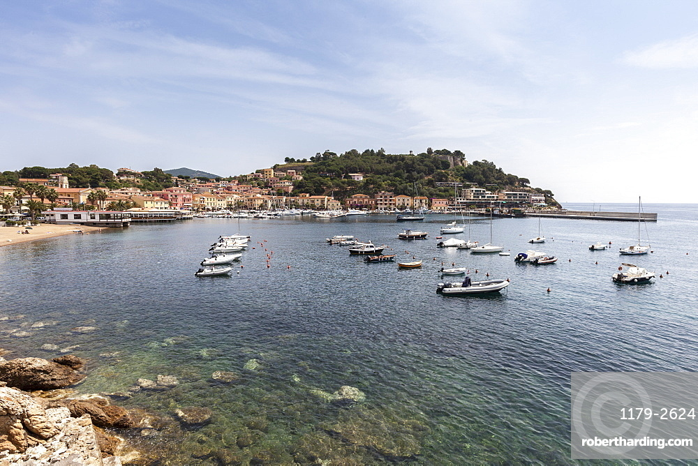 Boats moored in the harbor, Porto Azzurro, Elba Island, Livorno Province, Tuscany, Italy, Europe