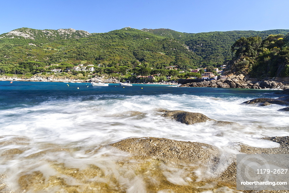 Waves crashing on rocks, Pomonte Beach, Marciana, Elba Island, Livorno Province, Tuscany, Italy, Europe