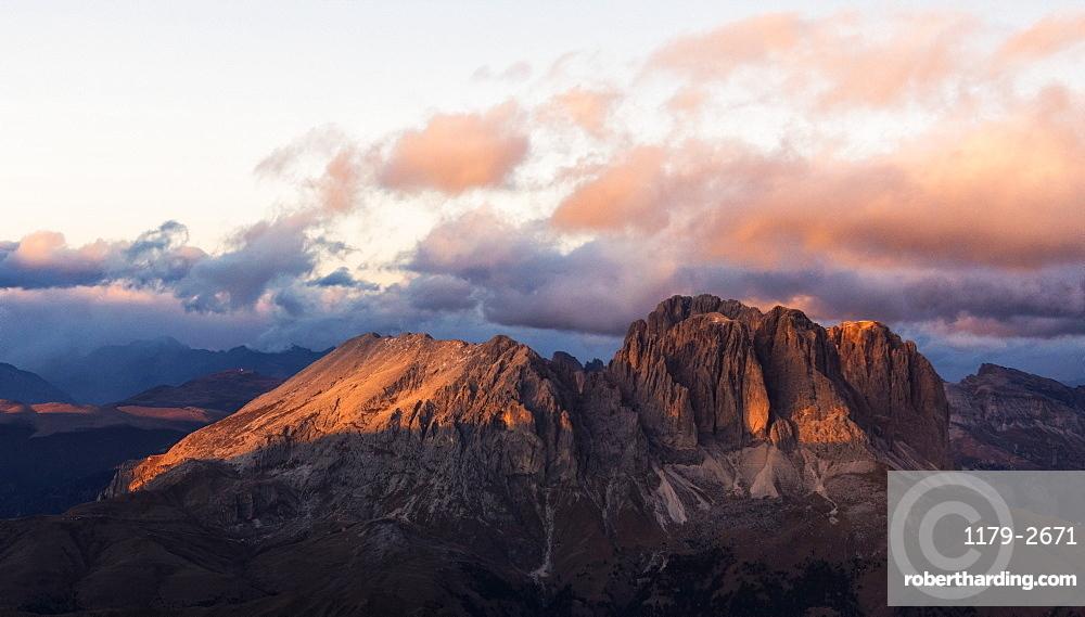 Aerial view of Sassolungo and Sassopiatto mountain range at sunset, Dolomites, South Tyrol, Italy